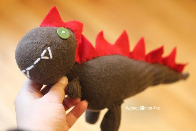 Sockasaurus (Sock Dinosaur)! Perfect project for the lone sock. Made with one child-size sock and minimal sewing skills.