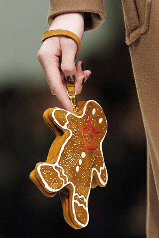 Arm cookie. Moschino gingerbread man clutch.