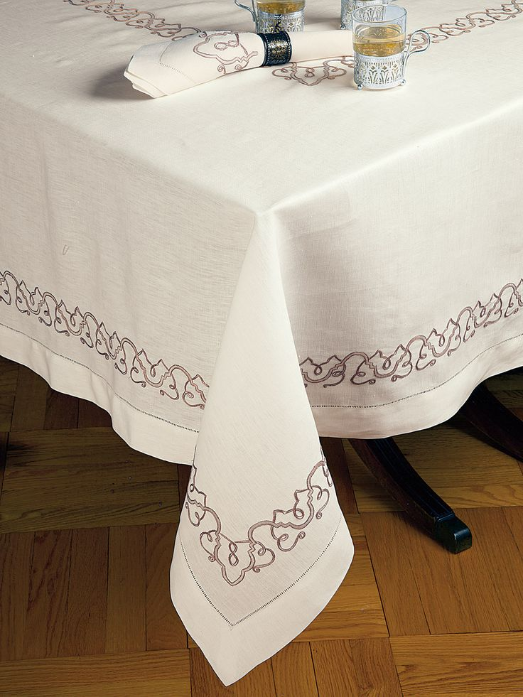 Tuscany - Luxury Table Cloths / Twining grapevines, bringing to mind an autumnal Tuscan harvest, have been recreated for your table in rich shades of Mocha and Ecru hand embroidery. Rendered with exquisite care on 100% Italian linen, the embroidery extends along the hem as well as the center of the table, where the unparalleled craftsmanship can be enjoyed by flickering candlelight.