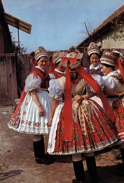 Hungarian regional folk costumes from Sióagrád - handpleated, full petticoats underneath, and headdress traditionally hand sewn with exquisite detail