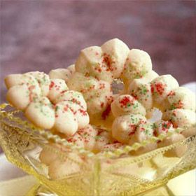 Spritz Cookies (Land O'Lakes). Easy Scandinavian spritz cookie recipe that is buttery rich and can easily be flavored with almond or lemon.