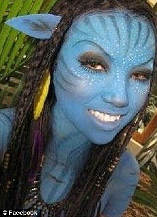 Double take: The self-taught make-up artist does her best recreation of Na'vi princess Neytiri from James Cameron's Avatar