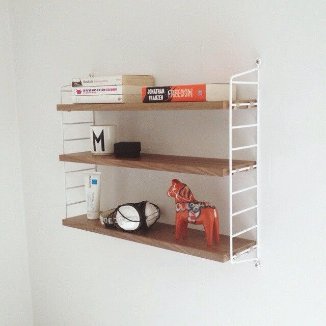 via meganisobel - Bought non-Ikea furniture because I'm an adult now. #joke #shelfie #nilsstrinning #stringshelf #vscocam