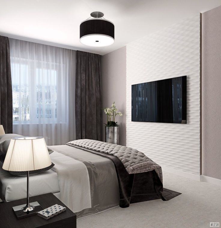 Спальня телевизор на стене