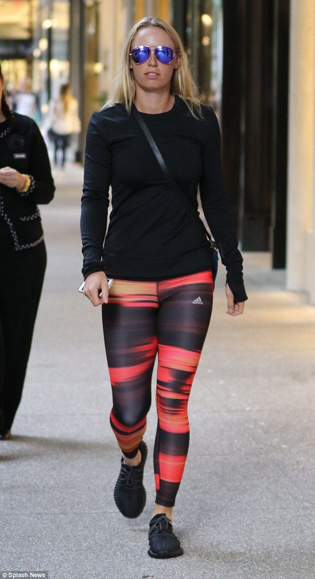 Casual: Caroline Wozniacki kept a low profile when she stepped out in Florida on Monday..her first sighting since ex-fiance Rory McIlroy announced his engagement to Erica Stoll