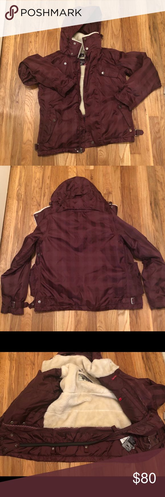 Burton Snowboarding Jacket Burton burgundy colored snowboarding jacket. Sherpa lined. Removable hood, has zippered vents for when you get hot on the slopes, can be attached to ski pants on the bottom. New without tags. Burton Jackets & Coats