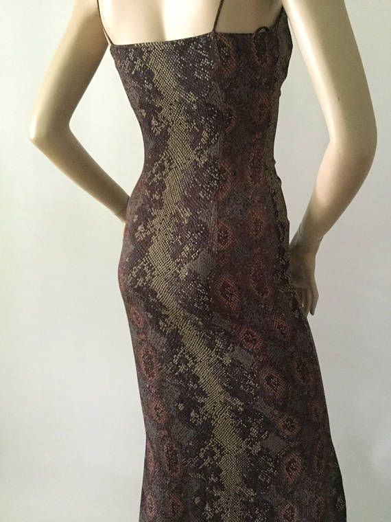 This is a rare piece from Rifat Ozbek, dating back to I believe the 1980s. This dress is stunning and has a texture to it and is in excellent condition. I see no signs of wear maybe worn once or twice . Please see picture roll for a little history on this award winning designer. See last picture in roll.