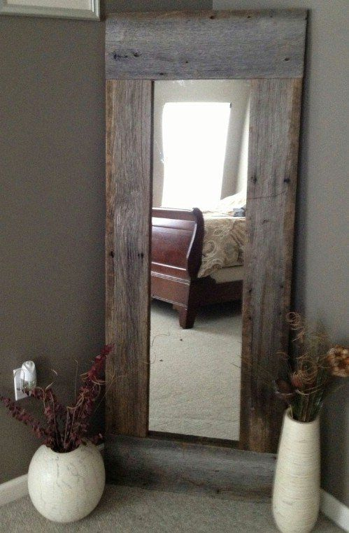 Use some reclaimed wood and a cheap Walmart or Target mirror to make a rustic full length mirror for the bedroom.