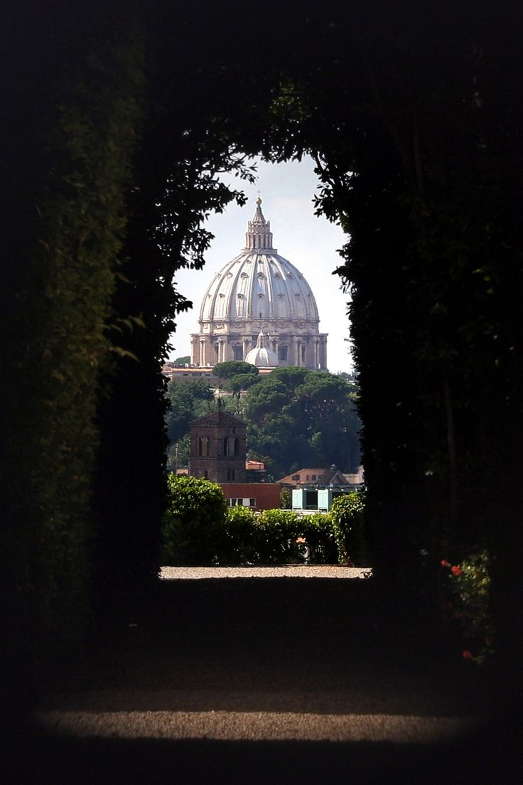 Saint Peter's Basilica through the keyhole at the Villa Malta - Rome, Italy