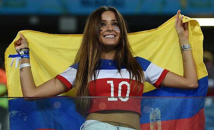 One of my favorite looks. Love the USA shirt and Colombian flag in the background. Her wristbands are awesome. And her hair and facepaint rock too!