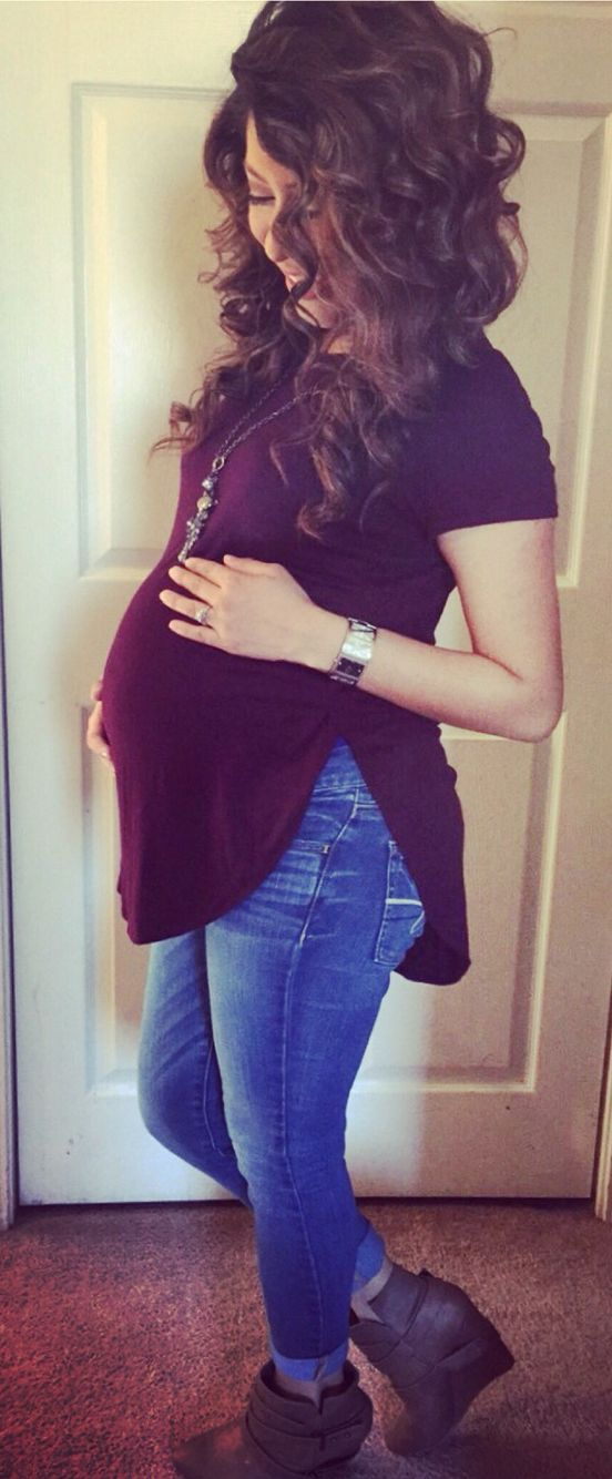 I like the interesting cut of this maternity top and the necklace.
