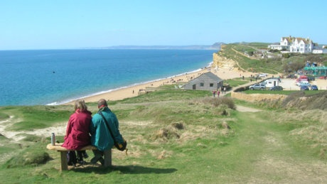 Taking in the view at Burton Bradstock, Dorset © National Trust