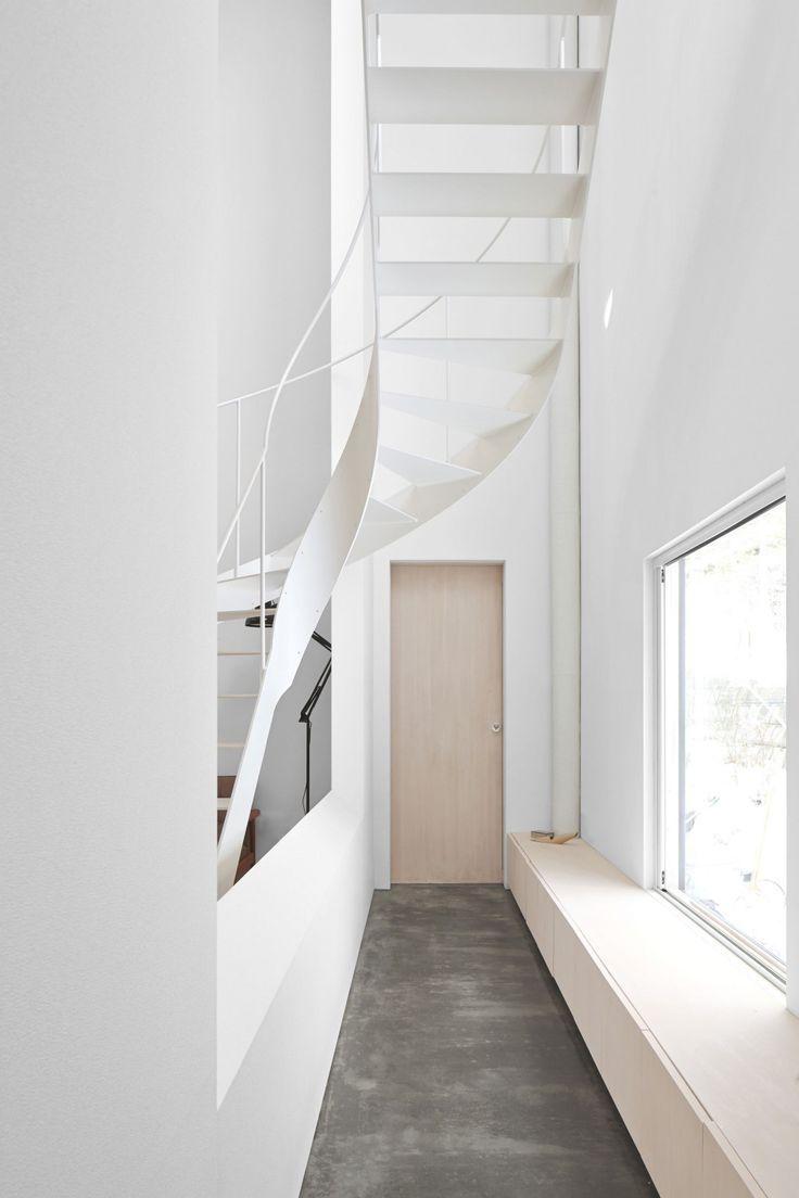 White Everything, Narrow Hallways & Doors, Winding Metal Staircase, Blonde Wood Window Bench // stark