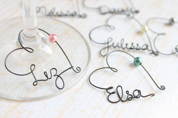 You should do this if you want a wine tour for your bachelorette party -- Personalized Wine Glass Charms $6.00