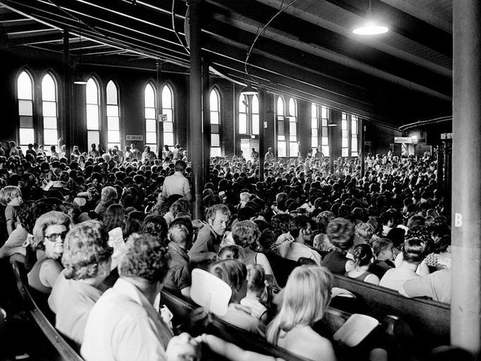 Country music lovers swish paper fans back and forth to cool off during a Saturday matinee performance July 14, 1973 at the Grand Ole Opry at the Ryman Auditorium. Stained glass windows along the wall keep out some of the glare, but Orpy officials say the inside temperature has reached as high as 110 degrees.