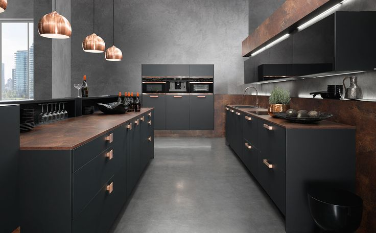 Love the black and copper combination in this kitchen