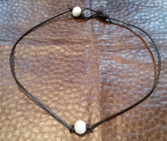 This is a leather pearl necklace made by my wife and I here in San Antonio, Texas. It is approximately 18 long and has a single pearl in the center and a single pearl for the clasp. The cord is 2mm dark brown genuine leather cord and the pearls are natural freshwater pearls that are each 11-14mm. If you have any comments or questions feel free to let us know and we will respond as soon as possible!  Thanks