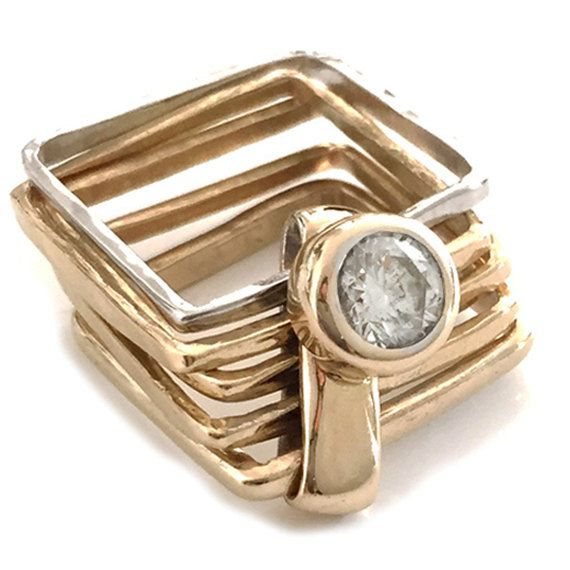 This gorgeous and unique contemporary engagement ring is Handcrafted in 18k yellow and white gold and is a set of 5 square rings linked together by a rectangle that can feature a stunning 0.5 CT GIA certified diamond set on a high bezel setting.  Inspired by geometry and Florentine architecture the city that nurtured my career as a goldsmith. The square ring is an absolutely unique piece with unspoken allure and sophistication. Its design remains timeless. Are you wondering if its…