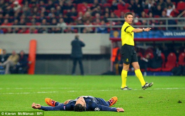 Robin van Persie lies on the floor after missing United's best chance of the game late on