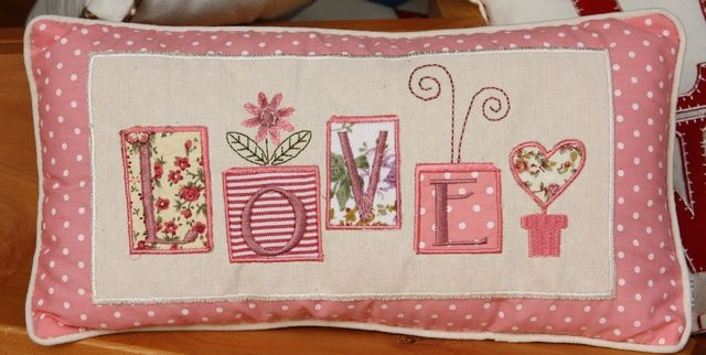 """LOVE"" rectangular cushion – embroidered and appliquéd in pinks – 17.5cm x 32.5cm"