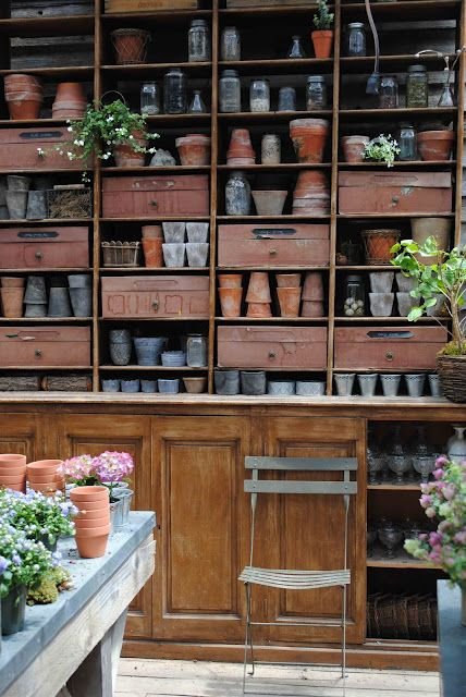 Organized potting shed with tons of pots..  Beautiful
