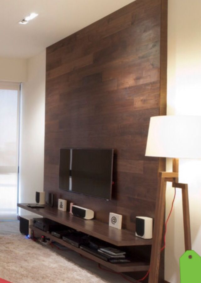 This TV wall is simple and effective. A shelf for equipment and a wooden wall to…