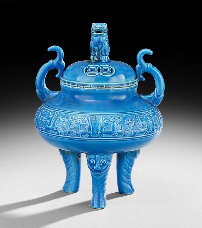 """Chinese Porcelain Incense Burner, early 20th century, with a monochrome turquoise glaze, the top pierced with cash coins and surmounted by a foo dog, with fish-form handles, a Ch'ien Lung mark on the base, h. 10"""", w. 7-1/2""""."""