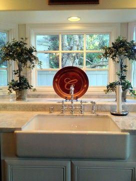 Manhattan Beach Rehab- White Kohler farmhouse sink, chrome farmhouse bridge kitchen faucet, marble countertops, venatino subway marble tile.