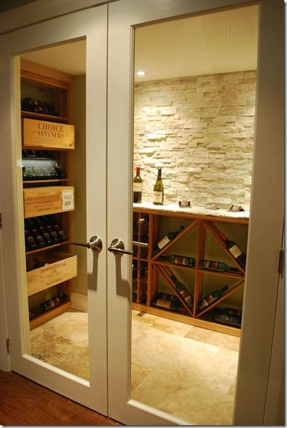 hmmm, an adult room in the basement?  Wine, leather chairs, and some good books