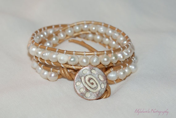 Pearl's a Singer - This sunning double leather-wrap bracelet is made using gold dyed leather, and beautiful freshwater pearls. Each pearl is perfectly imperfect and beautiful to wear. £35.00