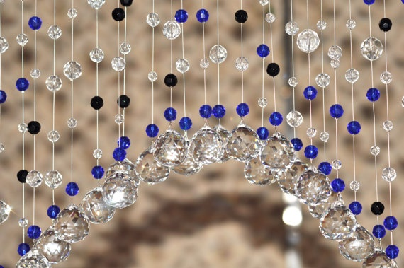 crystal beaded curtain,glass beads....I think maybe this might look good on a boring white shower curtain. Hang it on the rings.
