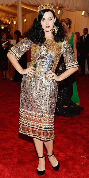 KATY PERRY - Met Gala 5-6-2013 Im Joan of Arc, the original punk, Katy jokes of her jewel-encrusted Dolce & Gabbana midi gown, which she pairs with a crown and chunky jewels. (We dont think shell make the list of fashion royalty this time, though.)