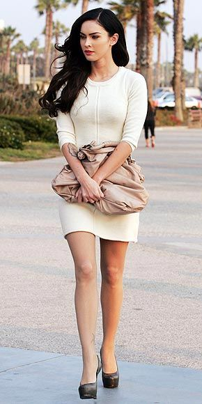Living up to her name, the foxy brunette is pinup-worthy in a cream sweater dress, taupe satchel, nude fishnets and ...
