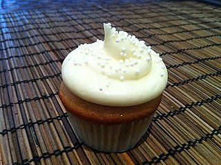 Guava Cupcakes With Cream Cheese Frosting  Super yummy! Top with marshmallow plumeria for a festive addition!