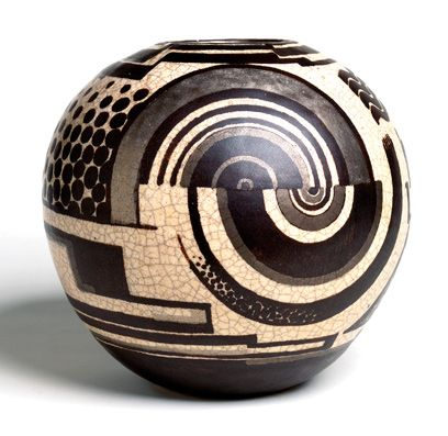 This Art Deco Vase was created by  by René Buthaud in Bordeaux, France. The vase is decorated with Deco style art with shapes that run into each other with no defined border. The vase is made of stoneware and with crackle glaze. This gives the vase texture.