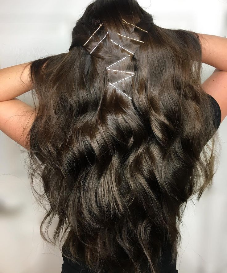Shiny dark espresso brown hair color by Aveda Artist Holly deCastri with a fun bobby pin detail.