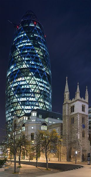 """30, St. Mary Axe """"The Gherkin"""" from Leadenhall St. at night."""