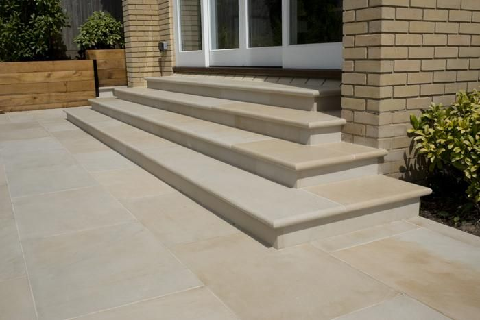 Harvest Sawn Sandstone Paving with matching bullnose step treads.  This stone works in contemporary and traditional garden settings