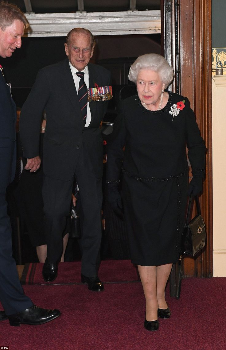 The Queen and Prince Philip are greeted as they walk into the ceremony, which this year ma...
