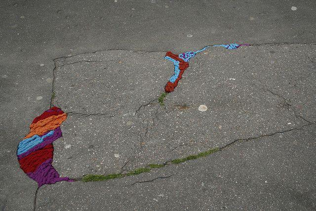 Juliana Santacruz Herrera: yarn in pot-hole series http://restreet.altervista.org/juliana-santacruz-herrera-restaura-le-strade-con-i-fili-colorati/