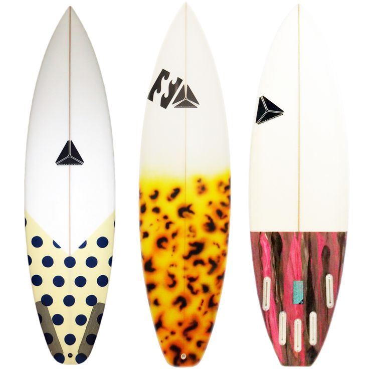 Savage model surfboards with tail dip artwork.