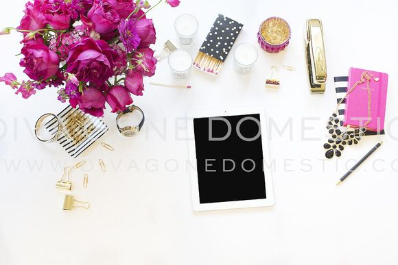 Tech iPad with hot pink bouquet of flowers, pouch, and white and pink candle holders. Shiny gold bangles, black necklace, stapler, clips, pens and watch. Perfect for Showcasing Your Business, Blog, Shop, Brand and Products! by divagonedomestic on Creative Market