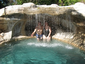 Swimming pool grotto with waterfall. Because who doesn't their own waterfall!!