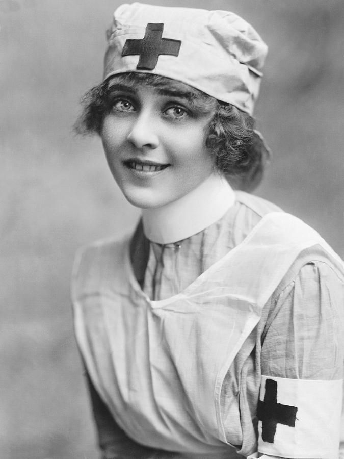 Red Cross Nurse. Hollywood, California c.1917. Silent film actress June Caprice wearing a Red Cross nurse's uniform as a promotion for buying WWI Liberty Loan Bonds.