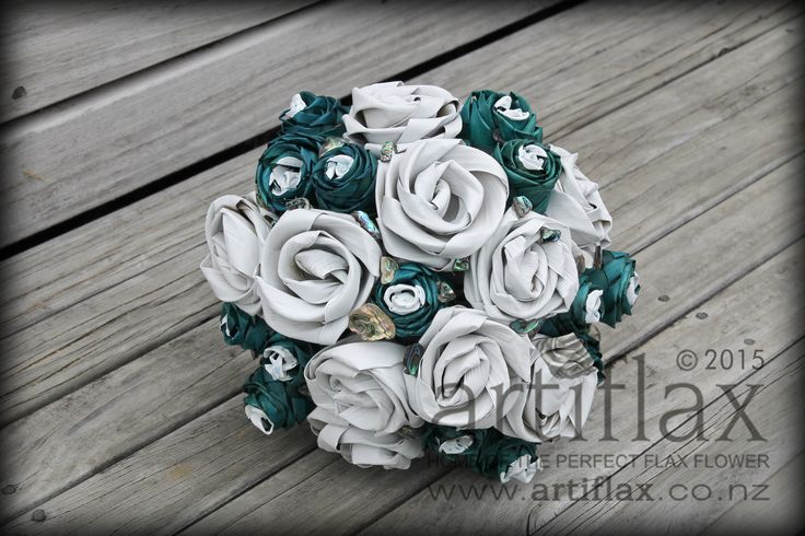 Flax flower wedding bouquet by Artiflax  Turquoise and white flax flowers with paua shell pieces
