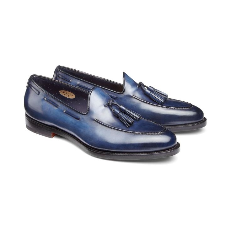 Tassel-loafers in soft antique-leather in nuanced shades of quiet mysterious blue, featuring visible stitching, coordinated leather-detailing on the sides, and leather soles with Goodyear welt-construction.