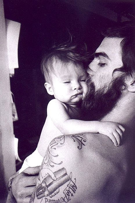 father and son. This will pretty much be me, a tattooed, bearded, scruffy haired fuck that's loves his kid.