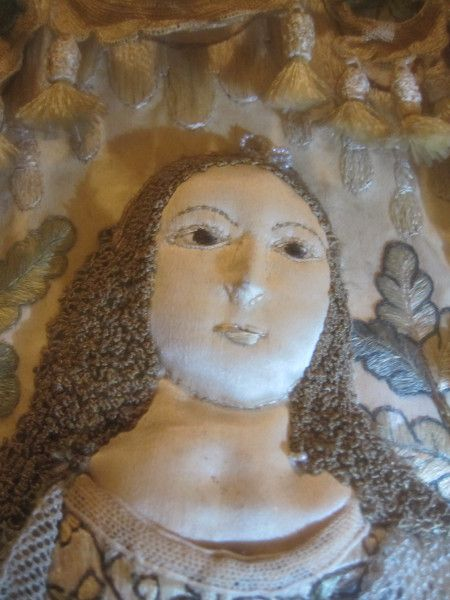 Female figure right - MET mirror surround in gallery pic 4 - close up of face