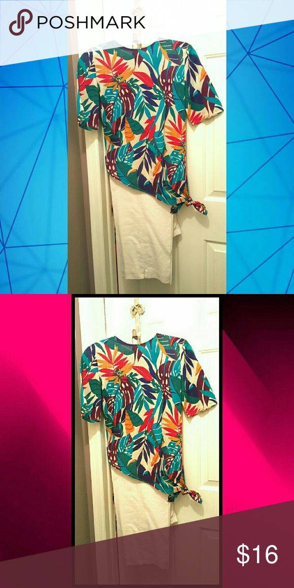 TROPICAL PRINT TUNIC TOP SIZE 6 Beautifully colored Hawaiian Print Top...Ties at the side with an asymmetrical look...worn once on cruise...non smoker...excellent pre-loved condition. Tops