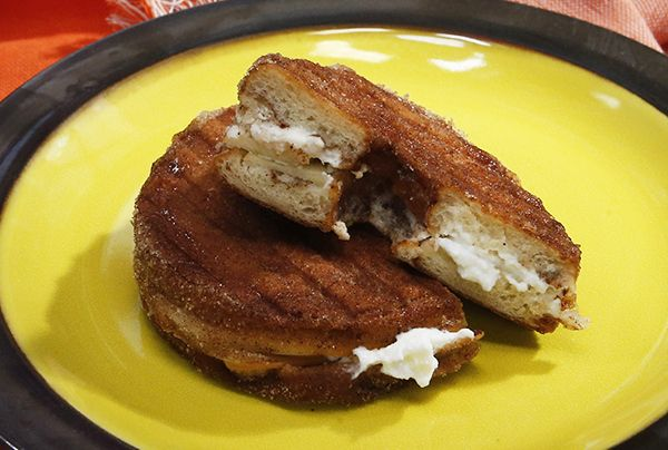 If you're left with day-old doughnuts this Halloween, revive them with your panini press! Katie Lee slices apple cider doughnuts in half and fills them with ricotta, thin apple slices, cinnamon and honey. Then she grills the doughnut sandwich, transforming it into a warm treat that is great for breakfast, dessert or even an after-school snack!